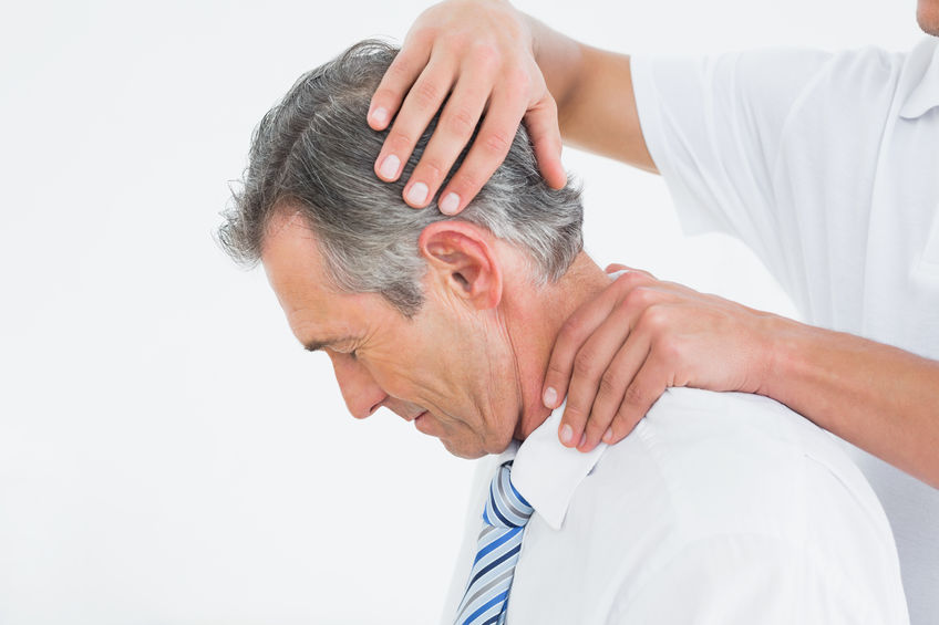 25503787 – side view of a chiropractor doing neck adjustment